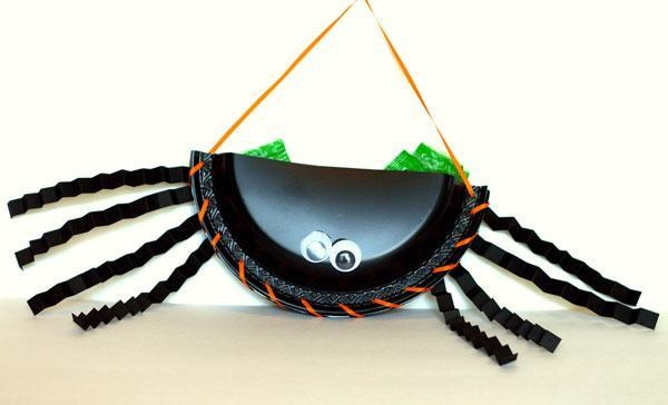 Make this silly spider candy holder!
