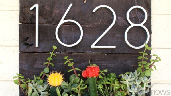 Upgrade the look of your home with a colorful DIY address planter box