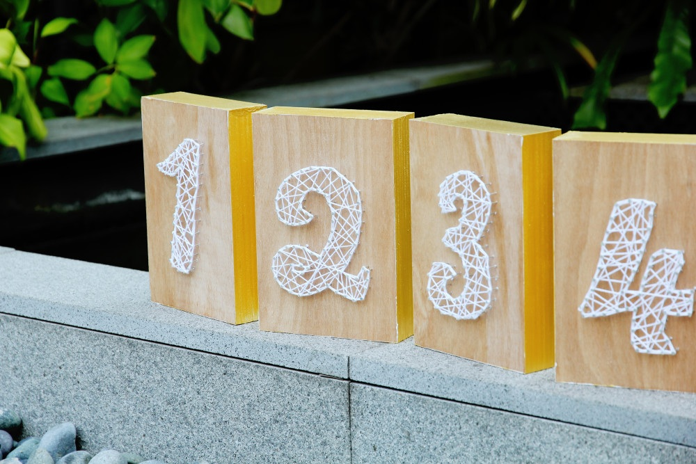 diy string art wedding table numbers
