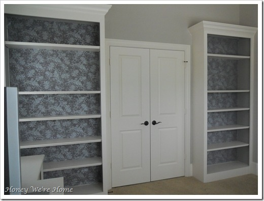 Spruce Up Your Built in Bookshelves With A Fabric Backdrop